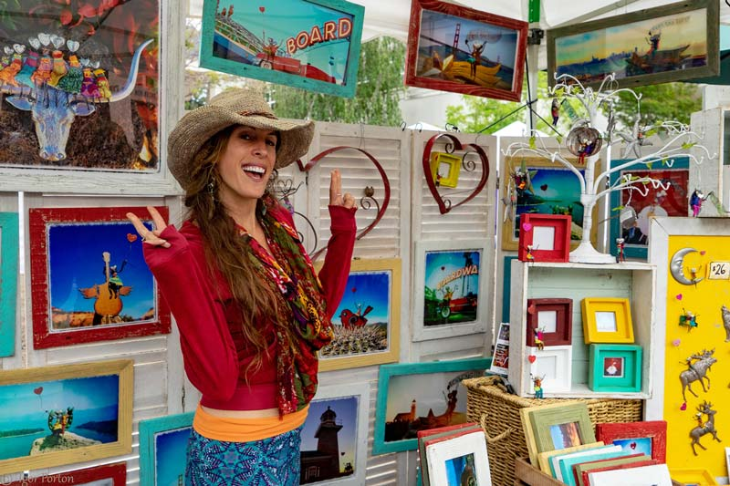 artist displaying her handcrafted work